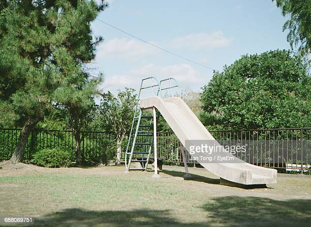playground against trees - leisure equipment stock pictures, royalty-free photos & images
