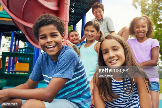playground and friends, fun guaranteed - pre adolescent child stock pictures, royalty-free photos & images