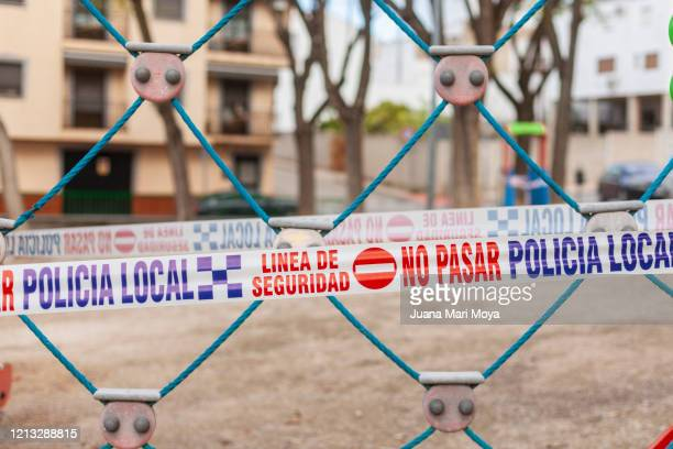 playground and park sealed by precaution.  concept of life under confinement  barrier tape in a playground, in a town in jaen, andalucia, spain, europe - cordon tape stock pictures, royalty-free photos & images