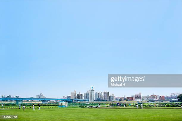 playground and town in blue sky and river area - 背景に人 ストックフォトと画像