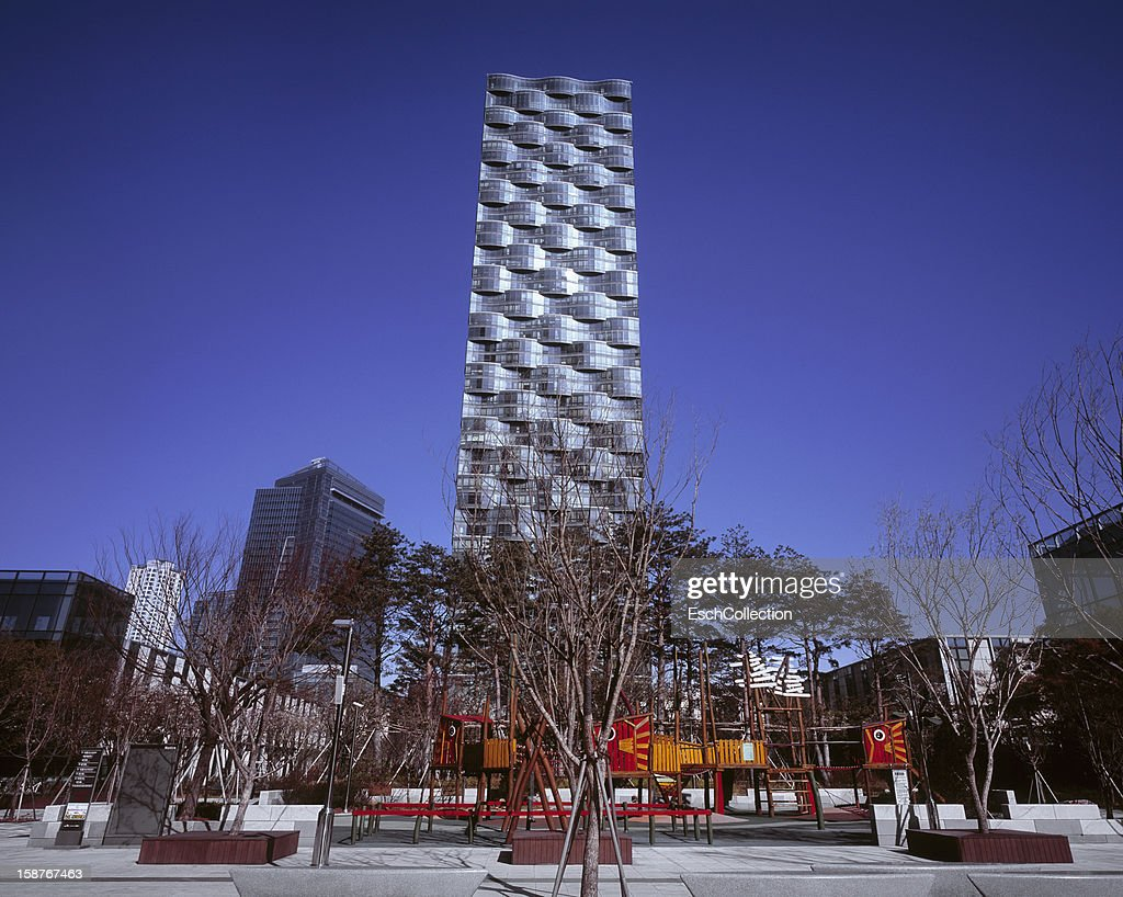 Playground between apartment and office buildings : Stock Photo