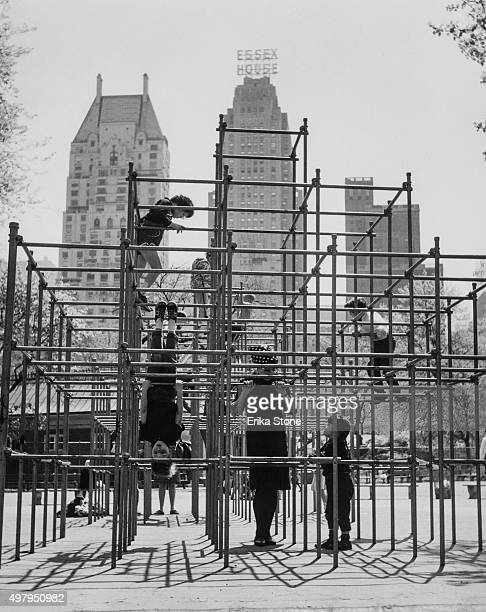A playground in Central Park New York City with Essex House in the background circa 1980