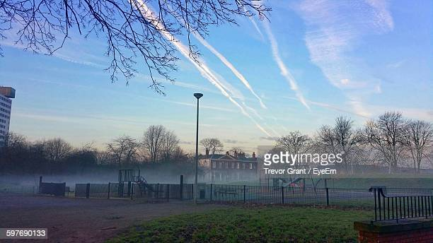 playground in city at sunrise during foggy weather - britain playgrounds stock pictures, royalty-free photos & images