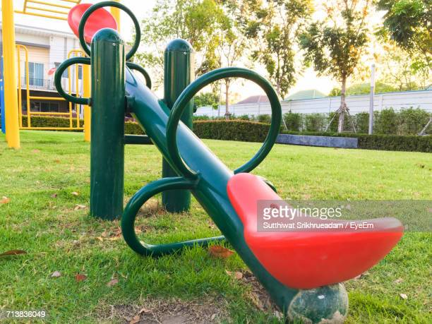 playground in park - seesaw stock photos and pictures