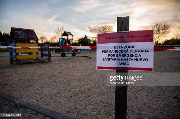 Playground is seen closed with a placard reading 'this area will remain closed for health emergency until further notice' as Spanish Government...