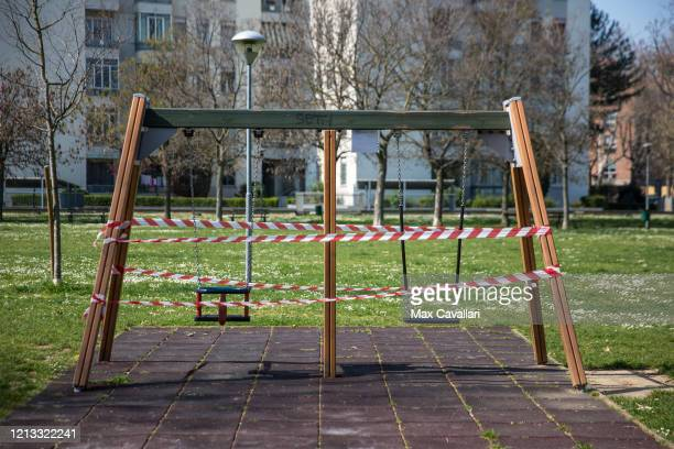 A playground is wrapped in red and white tape due to the emergency measurements on March 18 2020 in Bologna Italy The Italian government continues to...