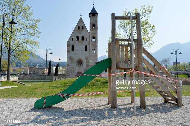 Playground, life under lockdown with barrier tape on a slide on April 12, 2020 in Various Cities, Italy. There have been well over 100,000 reported...