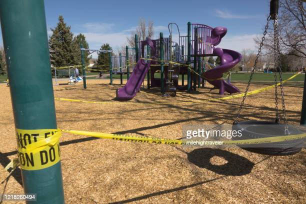 playground to limit coronavirus covid-19 spread closed sign do not enter south denver colorado park - milehightraveler stock pictures, royalty-free photos & images