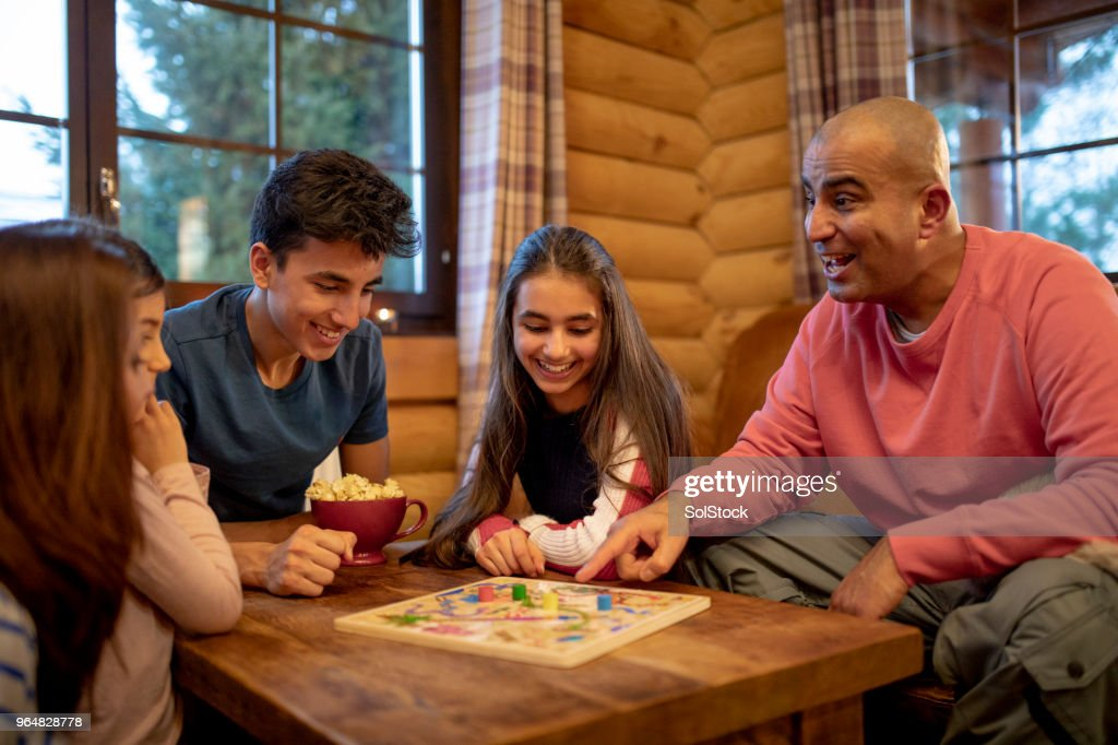 Playing a Board Game : Stock Photo