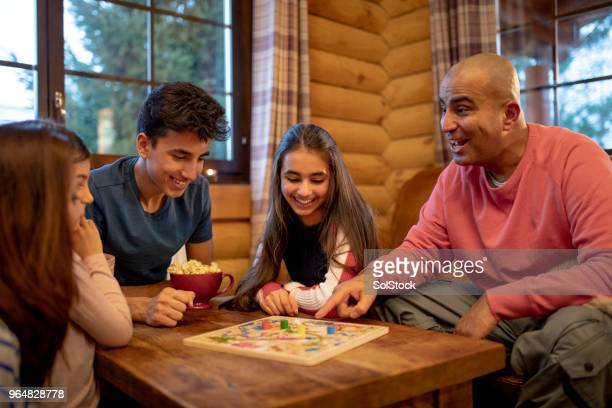 playing a board game - leisure games stock pictures, royalty-free photos & images