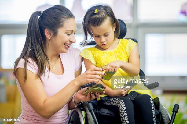 playing a card game - disabled stock pictures, royalty-free photos & images