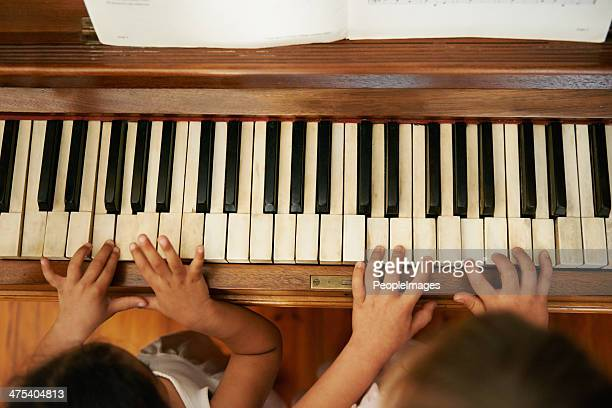 playing a duet - duet stock pictures, royalty-free photos & images
