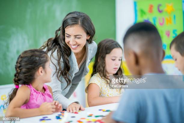 playing a game together - primary age child stock pictures, royalty-free photos & images