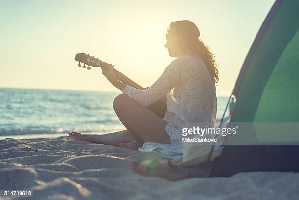 Playing a guitar at the beach