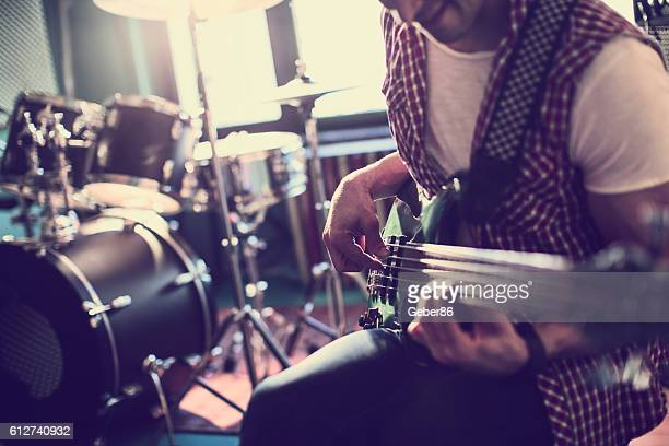 playing a guitar - rehearsal stock pictures, royalty-free photos & images