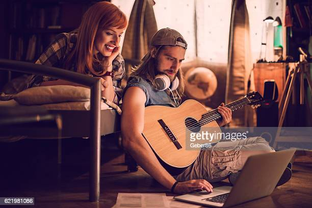 playing a guitar - plucking an instrument stock pictures, royalty-free photos & images