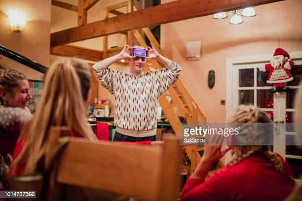 playing a modern guessing game at christmas - tag game stock photos and pictures