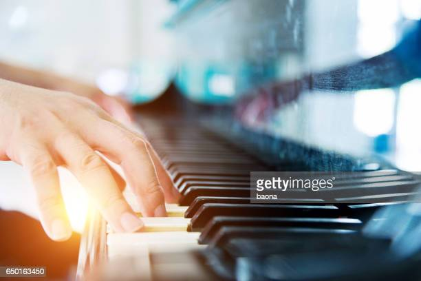playing a piano - keyboard player stock photos and pictures