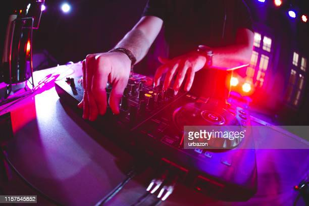 dj playing and mixing music at party - dj stock pictures, royalty-free photos & images