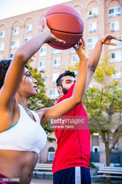 playing and teaching at basketball court - shooting baskets stock photos and pictures