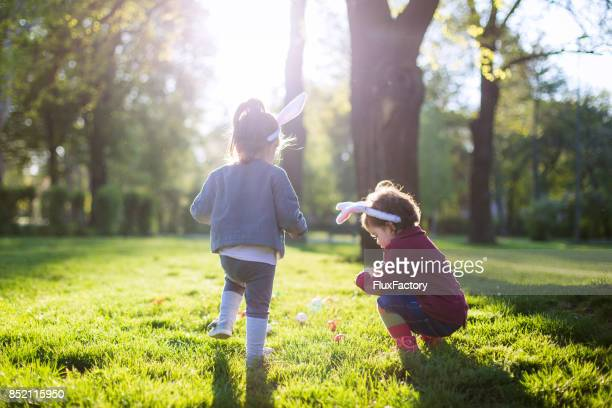 playing at easter time in the park - easter egg stock pictures, royalty-free photos & images