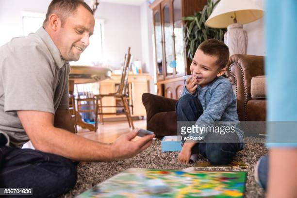 playing at home with kids - game board stock photos and pictures