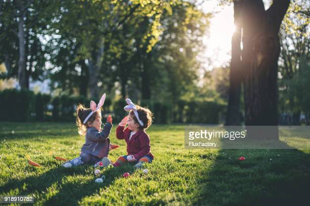 playing at the park during holidays - easter egg stock pictures, royalty-free photos & images