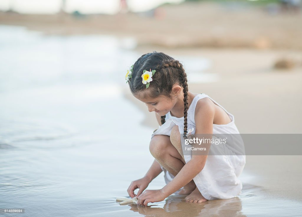 Playing at the Waters Edge : Stock Photo