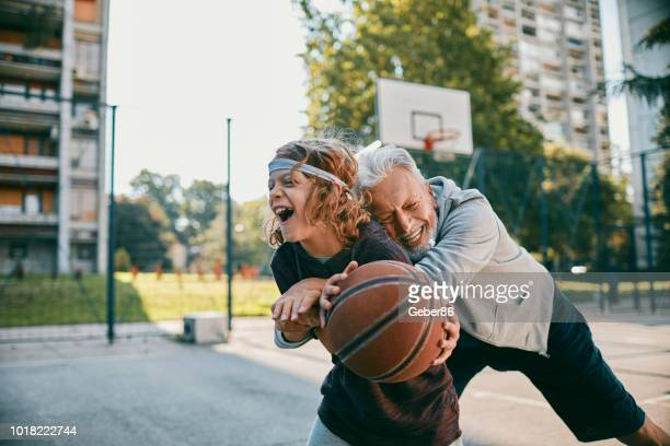 playing basketball - termine sportivo foto e immagini stock