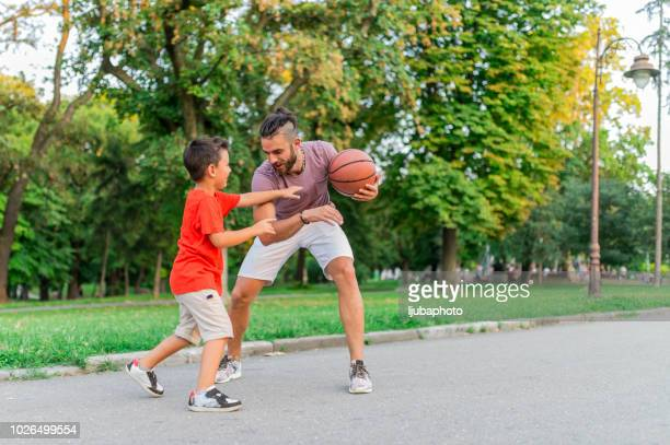 playing basketball - sporting term stock pictures, royalty-free photos & images