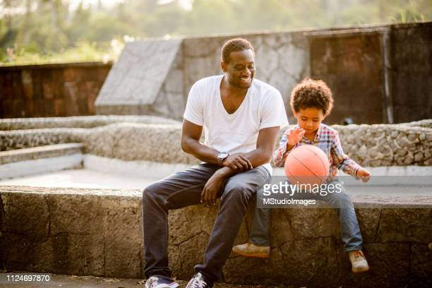 playing basketball - happy fathers day stock pictures, royalty-free photos & images