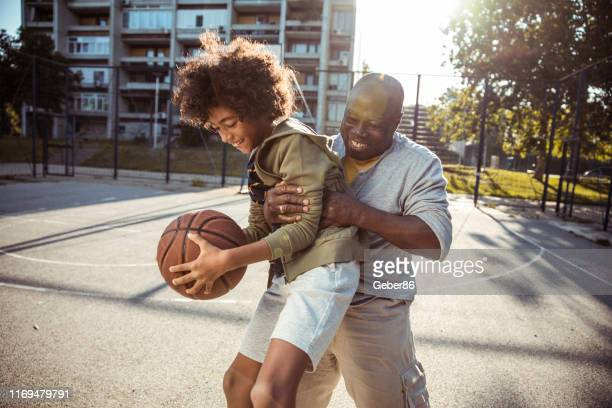 playing basketball - basketball sport stock pictures, royalty-free photos & images