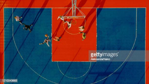 playing basketball - basketball player stock pictures, royalty-free photos & images