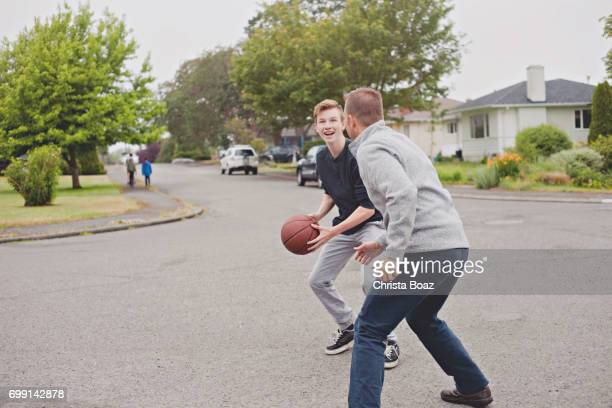 playing basketball - cul de sac stock pictures, royalty-free photos & images