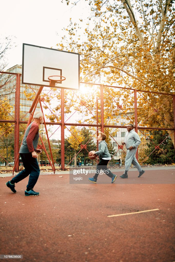 Playing basketball With Grandson : Stock Photo