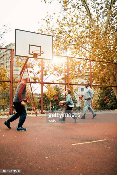 playing basketball with grandson - vertical stock pictures, royalty-free photos & images