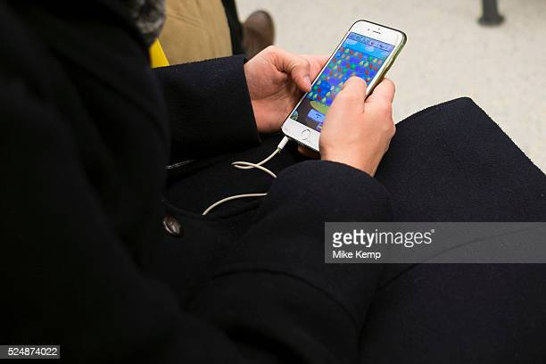 Playing Candy Crush on a mobile phone in London England United Kingdom Candy Crush is one of the most popular apps of all time