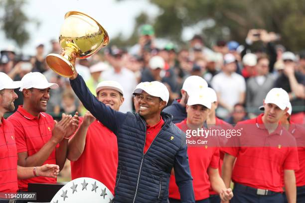 Playing Captain Tiger Woods and the United States team celebrate with the cup after they defeated the International team 1614 during Sunday Singles...