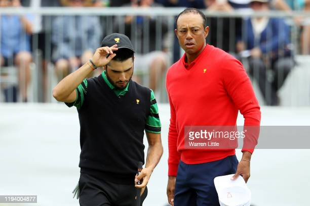 Playing Captain Tiger Woods of the United States reacts after defeating Abraham Ancer of Mexico and the International team 32 during Sunday Singles...