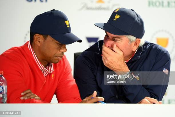 Playing Captain Tiger Woods of the United States team and Assistant Captain Fred Couples of the United States team talk during selections for...