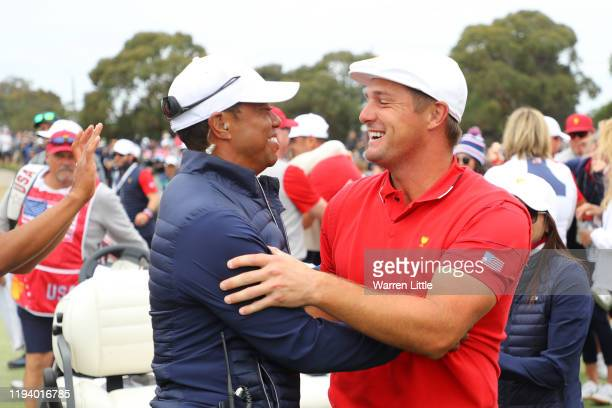 Playing Captain Tiger Woods of the United States team and Bryson DeChambeau of the United States team celebrate winning the Presidents Cup during...