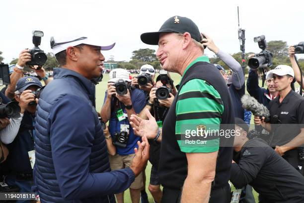 Playing Captain Tiger Woods of the United States team and Captain Ernie Els of South Africa and the International team shake hands after The United...