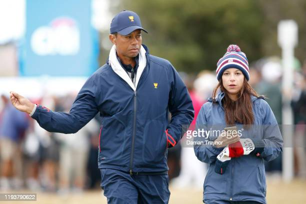 Playing Captain Tiger Woods of the United States team and girlfriend Erica Herman look on during Saturday four-ball matches on day three of the 2019...