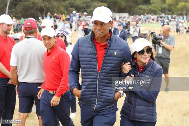 Playing Captain Tiger Woods of the United States team and girlfriend Erica Herman celebrate after winning the Presidents Cup 16-14 during Sunday...
