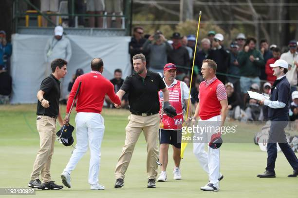 Playing Captain Tiger Woods of the United States team and Justin Thomas of the United States team celebrate defeating Marc Leishman of Australia and...
