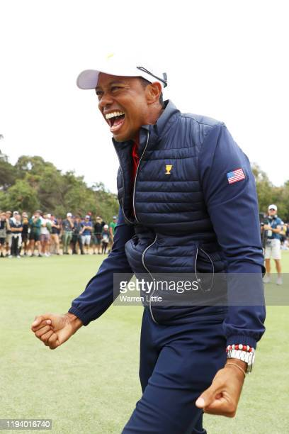 Playing Captain Tiger Woods of the United States team celebrates after clenching the Presidents Cup during Sunday Singles matches on day four of the...
