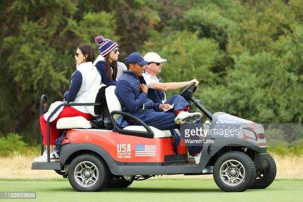 Playing Captain Tiger Woods of the United States team, girlfriend Erica Herman, and girlfriend of Justin Thomas of the United States team, Jillian...