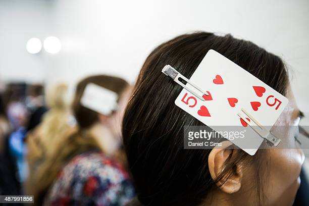A playing card clipped to a models hair indicating that the hair has been styled backstage at the Jill Stuart SS16 show as part of New York Fashion...
