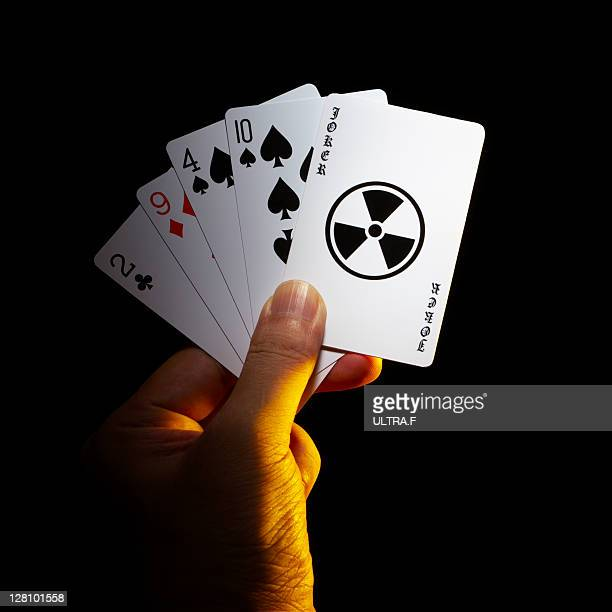 Playing card with radioactive sign
