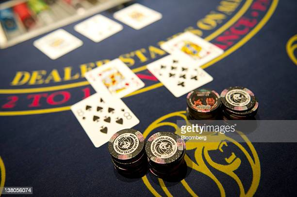Playing cards and chips are displayed on a blackjack table at the MGM Resorts International plays a hand of blackjack with a customer in Las Vegas...